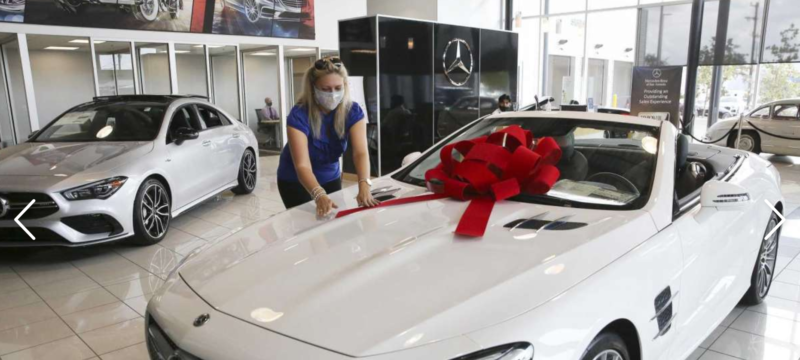Jacqueline makes the San Antonio Express-News showing off our custom bows!